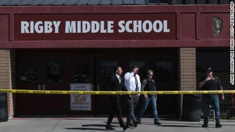 Officers leave Rigby Middle School after a  shooting in Rigby, Idaho on Thursday, May 6, 2021. Authorities say a shooting at the eastern Idaho middle school has injured two students and a custodian, and a male student has been taken into custody.  (John Roark /The Idaho Post-Register via AP)