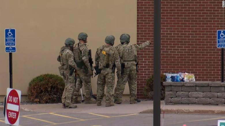 An attempted robbery at a Wells Fargo has turned into a hostage situation in Minnesota