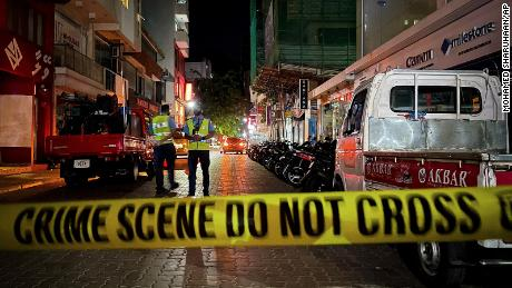 Maldivian police officers secure the area following a blast in Male, Maldives, May 6, 2021.