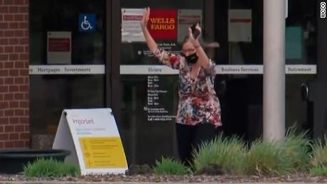 A woman is seen walking out of the Wells Fargo bank in St. Cloud, Minnesota, during an active hostage situation.
