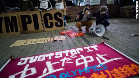"""A """"No Olympics"""" banner is displayed during a protest against the Tokyo 2021 Games."""