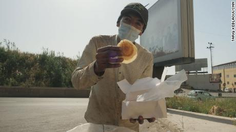 Ahmad finds a box of relatively clean atayef -- Middle Eastern pancakes -- from beneath a mound of garbage. He plans to serve it to his family during Iftar.