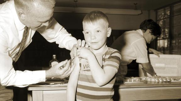 A doctor gives a measles vaccination to a boy in 1962 at Fernbank School in Atlanta.