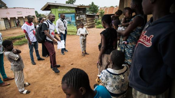 Red Cross officials in northeastern Democratic Republic of Congo meet with families in August 2019 to discuss fears surrounding Ebola and response teams.