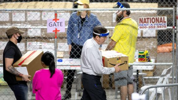 PHOENIX, AZ - MAY 01: Former Secretary of State Ken Bennett (right) works to move ballots from the 2020 general election at Veterans Memorial Coliseum on May 1, 2021 in Phoenix, Arizona. The Maricopa County ballot recount comes after two election audits found no evidence of widespread fraud in Arizona.  (Photo by Courtney Pedroza/Getty Images)