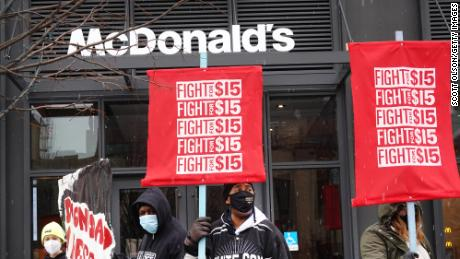 Demonstrators participate in a protest outside of McDonald's corporate headquarters on January 15, 2021 in Chicago.