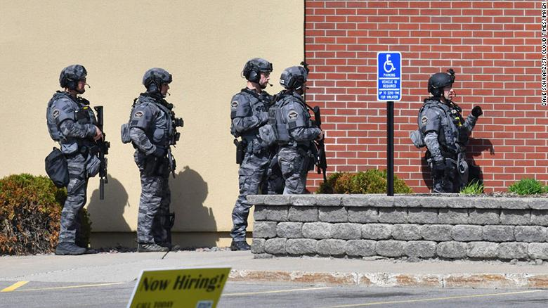 Suspect in Minnesota bank robbery threatened hostages and wanted a 'big show' with the FBI, authorities say
