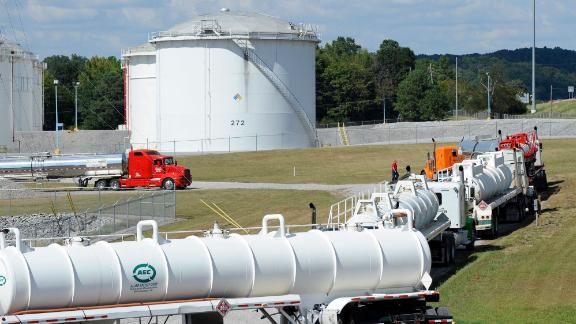 FILE - This Sept. 16, 2016, file photo shows tanker trucks lined up at a Colonial Pipeline Co. facility in Pelham, Ala., near the scene of a 250,000-gallon gasoline spill caused by a ruptured pipeline. The Georgia-based company has filed a federal lawsuit blaming an Alabama-based contractor, Ceco Pipeline Services, for the spill. (AP Photo/Jay Reeves, File)