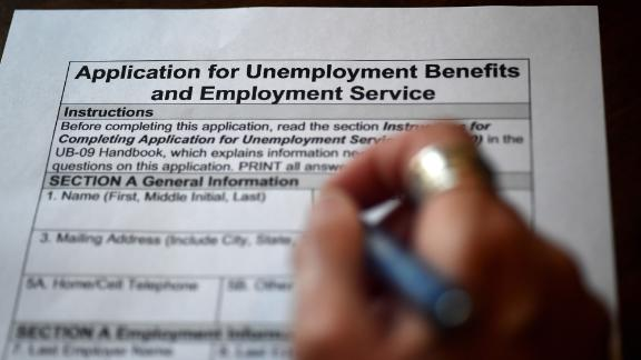 In this photo illustration, a person files an application for unemployment benefits on April 16, 2020, in Arlington, Virginia. - The government reported Thursday that another 5.2 million US workers filed for unemployment benefits, taking the four-week total to 22 million, a staggering figure in a downturn that economists say presents the country with its most severe outlook since the Great Depression of the 1930s. (Photo by Olivier DOULIERY / AFP) (Photo by OLIVIER DOULIERY/AFP via Getty Images)