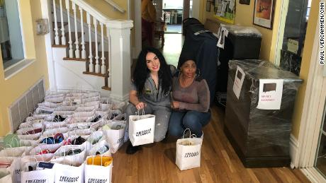 Laverne Delgado dropped off gift bags with fancy cosmetics and personal care items at a transitional home for women and children -   Laverne and Mimi Bangu hugged during the bag give away