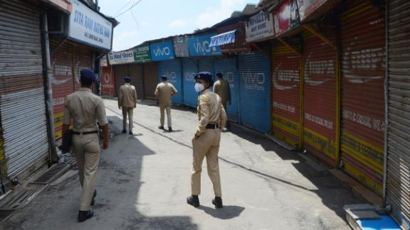 Police in Shimla patrol the streets of the Lower Bazaar area during a curfew on May 8.