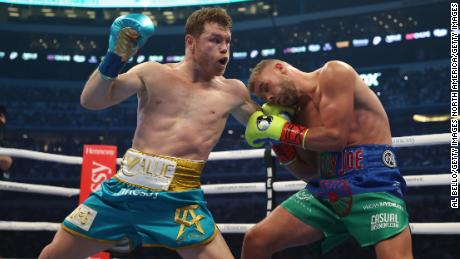 Canelo Alvarez defeated Billy Joe Saunders to claim the Briton's WBO super-middleweight title.