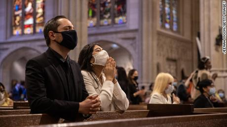 NEW YORK, NY - APRIL 04: People wearing protective masks pray during a mass at Saint Patrick's Cathedral on April 4, 2021 in New York City. The annual Easter Parade and Bonnet Festival on Fifth Avenue is going virtual for the second year, while COVID-19 safety protocols will be in place for Sunday's Mass at Saint Patrick's Cathedral. (Photo by Jeenah Moon/Getty Images)