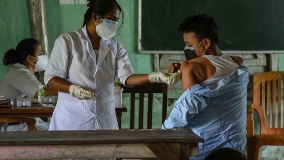 A young man receives a Covid-19 vaccine in Guwahati, India, on Saturday, May 8.
