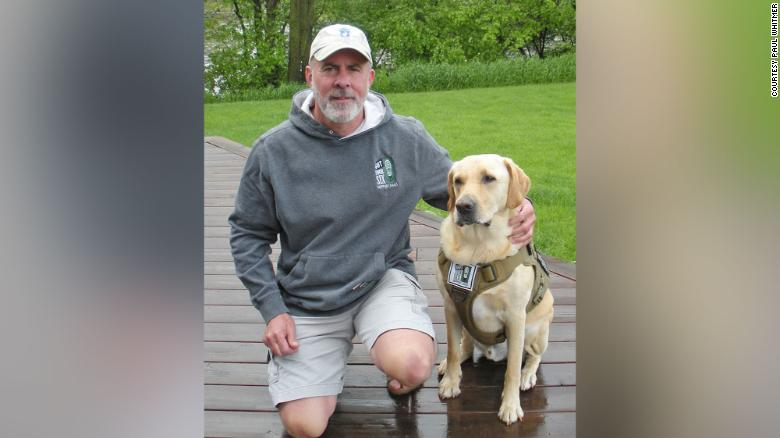 US Army vet Paul Whitmer, shown with his dog, Paul, now looks forward to going out in public.