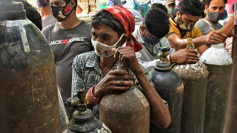 Indians wait to refill oxygen cylinders for Covid-19 patients at a gas supplier facility in New Delhi on May 8.