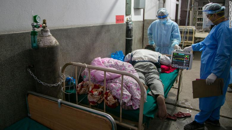 Nepali doctors treat a Covid-19 patient on the corridor of the emergency ward of a hospital in Kathmandu, Nepal on May 5.