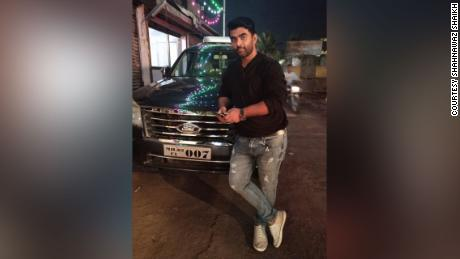 Shahnawaz Shaikh in his SUV, circa 2019, which he later sold to raise funds for his humanitarian work, providing free oxygen to those who couldn't find or afford it.