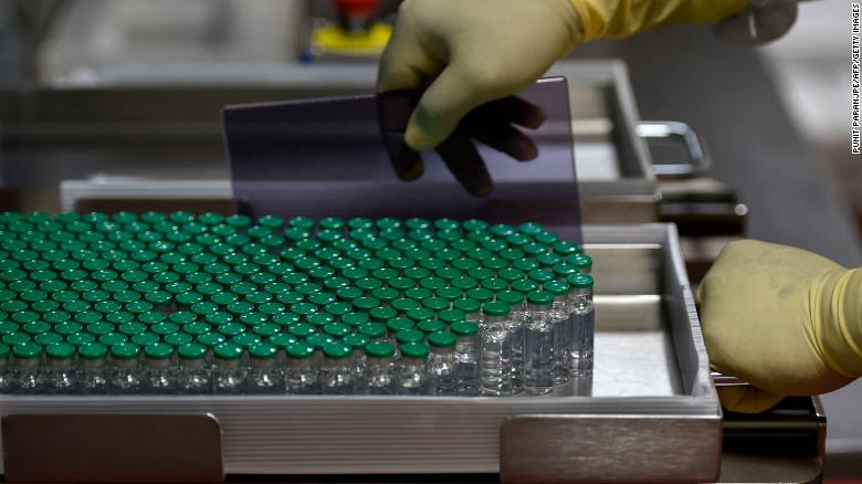 Vials of Covishield, AstraZeneca-Oxford's Covid-19 coronavirus vaccine are pictured inside a lab where they are being manufactured at India's Serum Institute in Pune on January 22, 2021.