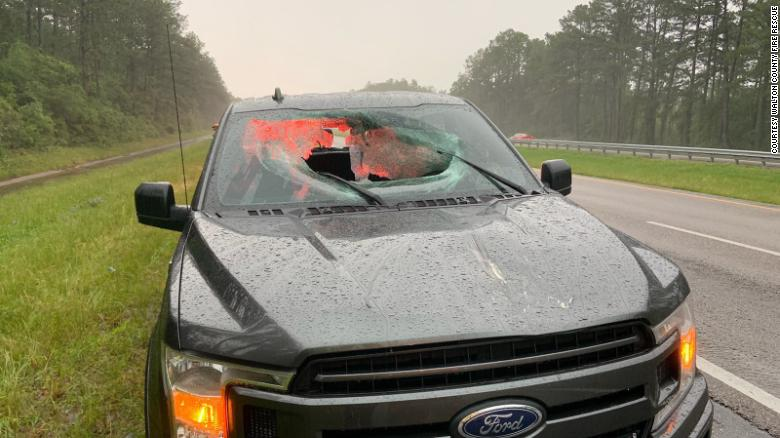 Chunk of highway goes flying through truck's windshield after lightning strikes road