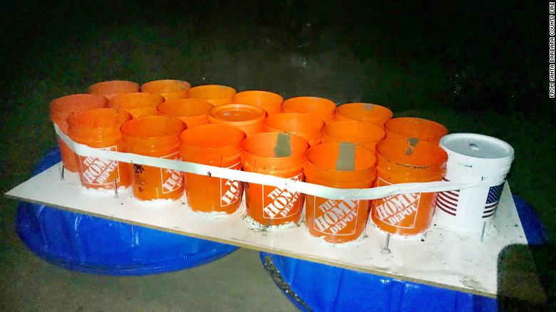 Two college students had to be rescued when their boat made of plastic buckets and kiddie pools drifted out to sea