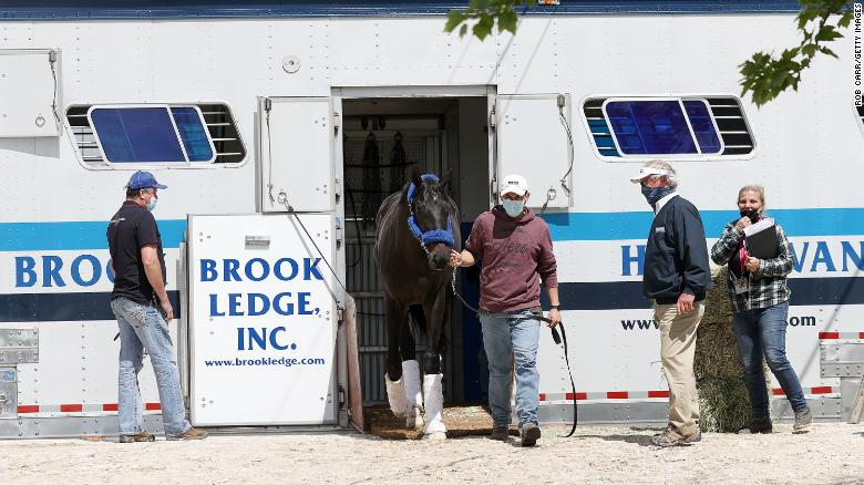 Medina Spirit has arrived at the Pimlico track. But it's unclear if he will race in the Preakness Stakes after failing drug test