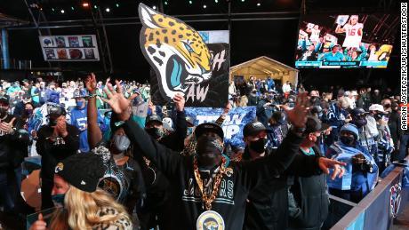 Fans celebrate as the Jacksonville Jaguars select Clemson quarterback Trevor Lawrence with the number #1 pick at the 2021 NFL Draft.