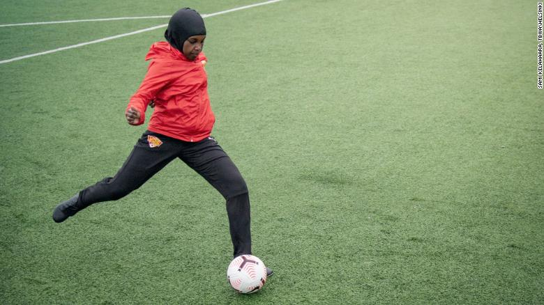 A player passes a ball while wearing a Nike Pro hijab.