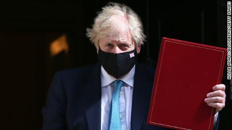Boris Johnson leaves Downing Street to attend the speech on Tuesday, days after his party enjoyed convincing victories in local elections.