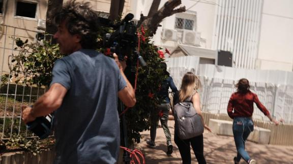 CNN's Hadas Gold, her team and residents rush to cover as warning sirens were heard in Ashkelon, Israel amid rising tensions between Israelis and Palestinians. Israel and Gaza militants have been exchanging fire after clashes in Jerusalem and an uptick in violence.