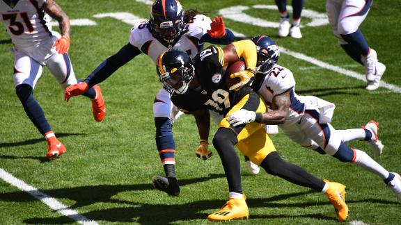 Smith-Schuster is tackled by Bradley Chubb and Kareem Jackson of the Denver Broncos.