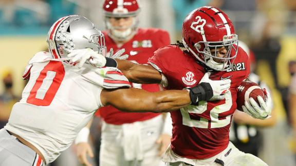 Najee Harris rushes against the  Ohio State Buckeyes during the second quarter of the College Football Playoff National Championship game.