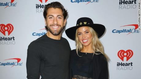 Jason Tartick and Kaitlyn Bristowe attend iHeartRadio ALTer EGO presented by Capital One at The Forum  in January 2020 in Inglewood, California.