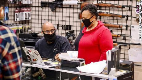 NAAGA executive board member Geneva Solomon (right) and her husband Jonathan work behind the counter at Redstone Firearms in Burbank, California.