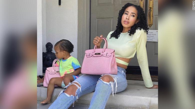Entrepreneur Kay Cola, (pictured here with her young daughter) started her Birkin handbag collection in 2020.