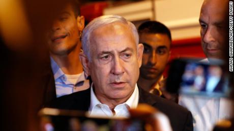 Israeli Prime Minister Benjamin Netanyahu tours the city of Lod early on Wednesday.