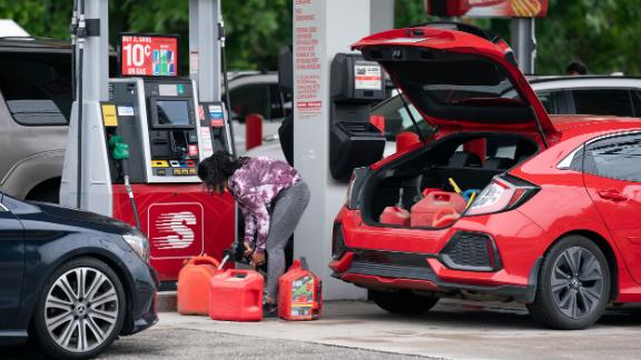 BENSON, NC - MAY 12:  A woman fills gas cans at a Speedway gas station on May 12, 2021 in Benson, North Carolina. Most stations in the area along I-95 are without fuel following the Colonial Pipeline hack. The 5,500 mile long pipeline delivers a large percentage of fuel on the East Coast from Texas up to New York. (Photo by Sean Rayford/Getty Images)