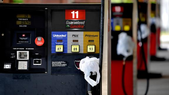 A QuickTrip connivence store has bags on their pumps as the station has no gas, Tuesday, May 11, 2021, in Kennesaw, Ga.
