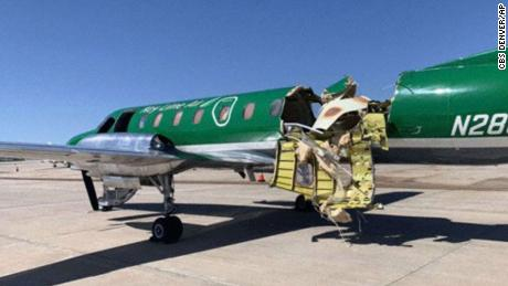 This image from CBS Denver shows a Key Lime Air Metroliner that landed safely at Centennial Airport after a midair collision near Denver on Wednesday.