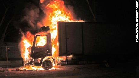 A truck burns at the entrance to the Jewish-Arab mixed city of Lod, where a state of emergency has been declared.