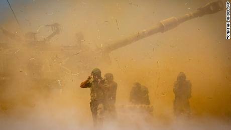An Israeli artillery unit shoots at Gaza targets.
