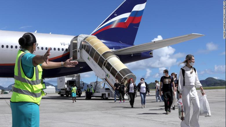 Passemgers leave a Boeing 777-300ER plane from Russia to Mahe Island, Seychelles, in April 2021.