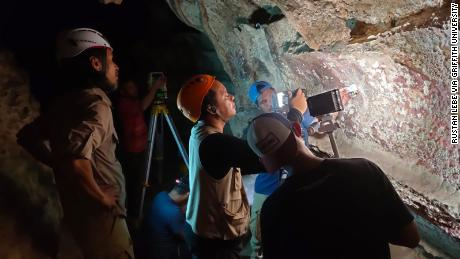 Staff from the BPCB conservation agency monitor the rock art in Maros-Pangkep