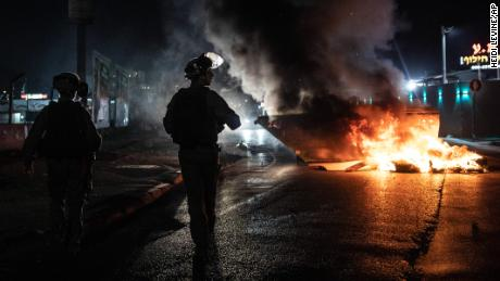 Israeli police patrol in the city of Lod, on May 12.
