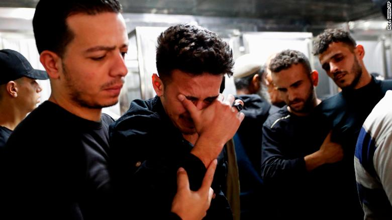 Relatives mourn Wednesday during the funeral of Reema Telbani and her 5-year-old son Zaid, who were killed in an airstrike on Gaza City.