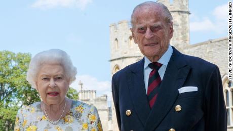 Queen Elizabeth II and the Duke of Edinburgh posed for a portrait last June in the quadrangle of Windsor Castle ahead of Philip's 99th birthday.