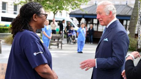 Charles speaks with nursing staff during a visit to St. Bartholomew's Hospital.