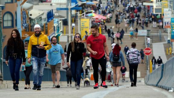Pedestrians are shown in Santa Monica, California, on May 13, when the CDC said vaccinated people can go maskless in most outdoor and indoor settings. The guidance does not apply to kids under age 12.