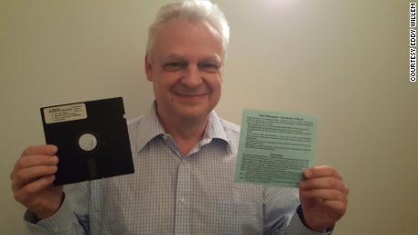 Eddy Willems with his original floppy disc with ransomware from 1989