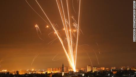 Rockets light up the night sky as they are fired towards Israel from Beit Lahia in Gaza Strip on May 14.